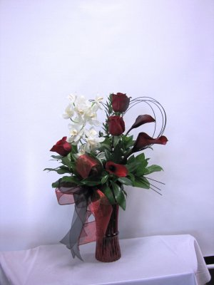 A Red Roses With White Orchids & Calas