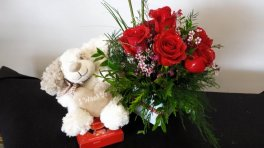 adorable bear with red roses