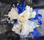 A corsage White Spray Rose Corsage with Blue Accents