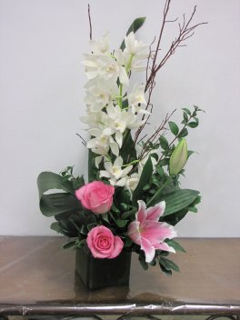 An Orchid, Lily, And Rose Medley