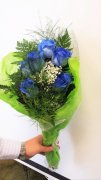 6 blue roses with fresh flower accents