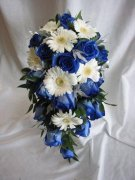 A Cascade With Blue Roses with White Gerbera Daisies