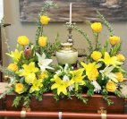 1 flowers around urn yellow roses yellow lilies