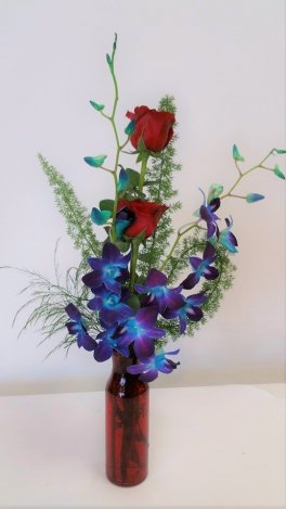 2 blue orchids 2 red roses vase arrangement