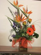 1 1 Birds of Paradise, gerbera daisies. roses. orange flowers
