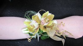 a corsage orchids yellow, wristlet