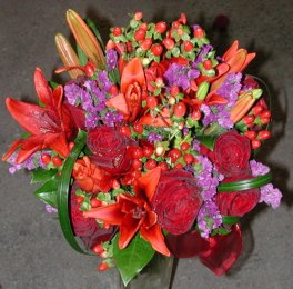 Hand tied Roses Lilies Status