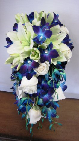 A Beautiful Cascade with Blue Orchids and White Lilies