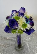 a bridemaid bouquet purple roses, blue purple orchids bling lime
