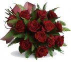 12 red roses handtied bouquet with floral accents