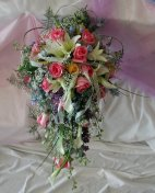 A Cascading Bouquet with Lilies, Roses and Orchids