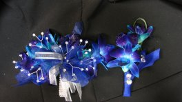 A Blue Orchid Wrist Corsage & Boutiniere