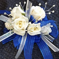 0 a wrist corsage with roses and flair 1